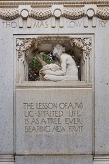 A sculpture depicting a woman gathering fruit on the 1915 Thomas Lowry memorial at Smith Triangle Park in Minneapolis, Minnesota, USA - The monument was designed by Austrian-born sculptor Karl Bitter.   The dedication reads: The lesson of a public-spirite (thstrand) Tags: 20thcentury adult adultfemale advice agegroups american americans art arts artwork carvedstone carving civicmemorial culturalheritage decorativeart dedication dedications femalefigure gatheringfruit historic history inscription karlbitter lesson lessonslearned lowryhill mn meataphor memorial memorials midwest midwestern minneapolis minnesota monument monuments nobody outdoors outside parks proverb publicart saying sayings sculpture smithtrianglepark text thomaslowry thomaslowrymemorial truth twincities type us usa unitedstatesofamerica vintage visualarts wisdom woman