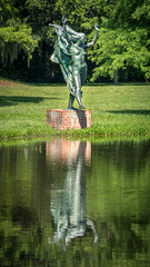 Running Against the Wind (dayman1776) Tags: sculpture statue skulptur sony a6000 escultura sculptures beautiful beauty female woman nude naked art museum fine brookgreen gardens south carolina outdoor pond lake reflection reflecting windy