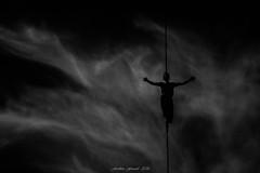 Au Fil des Cieux (Frédéric Fossard) Tags: monochrome noiretblanc blackandwhite clairobscur slackline highline funambule dark surréaliste surreal ciel sky nuage cloud sportextrême équilibre aérien ombre lumière light shadow chamonix chamausommet croix cross silhouette fil sangle