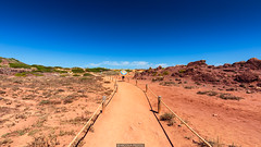 Life on Mars (Nicola Pezzoli) Tags: menorca baleares baleari island nature spain sea minorca isola red sand rock mars cala pregonda blue sky umbrella