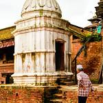 Man walking by a Hindu Shrine in Bhaktapur, Nepal thumbnail