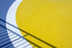 Shadowplay on a circle (Jan van der Wolf) Tags: map189328vv fence boat ship geometric geometry geometrisch geometrie abstract shadowplay shadow shadows schaduwen hek circle cirkel white wit yellow blue geel blauw lines playoflines interplayoflines lijnen lijnenspel