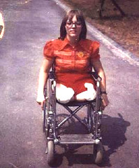 1960s High DAK girl with specs (jackcast2015) Tags: wheelchair leglesslady amputee dakamputee disabled disabledwoman disabledlady crippledlady crippledwoman spectacles glasses