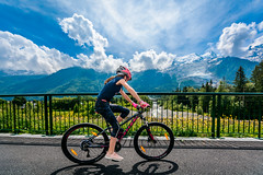 Riding on the Mountains (andrebatz) Tags: riding bike outdoor sports bicycle chamonix mont blanc mountains sightseeing travel girl sunny cold winter france french alpe alpes border cycling rocky landscape sigma lens wide angle nikon d7100