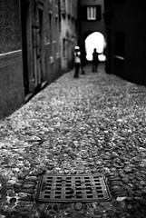 Manhole covers and people / No. 4 (Leica M6) (stefankamert) Tags: stefankamert street manholecover manholecoversandpeople film analog grain bokeh blur blurry dof leica m6 leicam6 summicron dr dualrange textures people kodak trix blackandwhite blackwhite noiretblanc noir bellagio italy oldtown alley sangiovanni