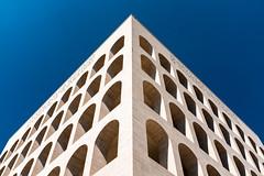 EUR Building Fragments (ep_jhu) Tags: lines x100f repetition fascism italia fujifilm bluesky blue italy arches rome fuji roma highcontrast corner eur edge white it explore