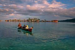 women's boat (Collin Key) Tags: bajau goldenhour women child sulawesi togianislands village malenge boat pulaupapan bajo indonesia sea tojounauna sulawesitengah indonesien id