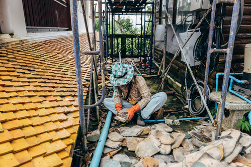 Sorting removed roof tiles, Doi Suthep. Chiang Mai, Thailand