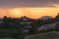 Sunset at Hampi (Rohit Tulsiyan) Tags: sunset hampi karnataka rock landscape mountain sky grass tree cloud light filtered lights rays