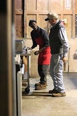 """Allen Askew speaks with Kendrick Milton, """"Dickey"""", who is a longtime employee, inside the restaurant. """"It's hard to find people as good as Dickey,"""" Askew said."""