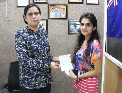 Ms. Parwinder Kaur (Director of West Highlander) handing over Poland Student Visa to Sanya Vij