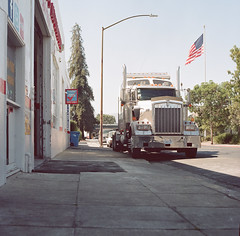 Redwood City (bior) Tags: hasselblad500cm carlzeiss portra160nc kodakportra expiredfilm mediumformat 120 6x6cm suburbs redwoodcity truck semi flag sidewalk street cab