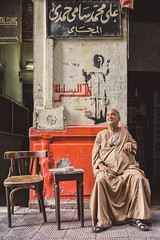 Egyptian (u c c r o w) Tags: portre portrait arab arabian egypt egyptian cairo kahire street cafe old man chair red uccrow arabic graffiti streetart
