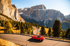 Retirement. (¡arturii!) Tags: dolomiti dolomites mountain mountainpass mercedesbenz 190sl red convertible freedom old retirement guy men road view landscape nature travel trip vacations rock crag curves winding sunny day autumn colors magic sky tree natura