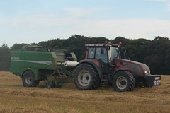 Valtra T180 Tractor with a McHale Fusion 2 Combi Baler & Wrapper (Shane Casey CK25) Tags: valtra t180 tractor mchale fusion baler agco purple bale bales baling 2 combi wrapper traktor traktori tracteur trekker trator ciągnik glenville grain harvest grain2018 grain18 harvest2018 harvest18 corn2018 corn crop tillage crops cereal cereals golden straw dust chaff county cork ireland irish farm farmer farming agri agriculture contractor field ground soil earth work working horse power horsepower hp pull pulling cut cutting knife blade blades machine machinery collect collecting nikon d7200