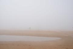 essaouira 1 (With The Crash Of Each Wave) Tags: africa morocco ocean atlantic essaouira loneliness alone mist fog beach distance