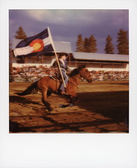 Rodeo Flag Bearer 1 (tobysx70) Tags: polaroid originals color 600 instant film slr680 roidweek roid week polaroidweek fall autumn october 2018 rodeo flag bearer high country stampede county road 73 fraser colorado co cowgirl horse rider state galloping motion blur polaradoone polarado 072118 day1 toby hancock photography