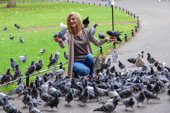 Crowdpleaser (James_D_Images) Tags: person woman park feeding pigeons birds flocking ststephensgreen dublin ireland posing eyecontact candid