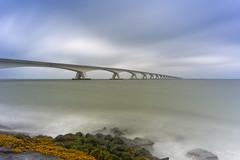 Zeeland Bridge (Johan Konz) Tags: zeelandbridge bridge water sea waves sky clouds rocks longexposure le outdoor seascape landscape waterscape nikon d7500 colijnsplaat netherlands