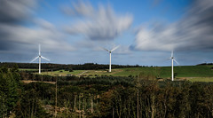 Turbines In Motion (Mark Wasteney) Tags: telegraphtuesday htt turbines power electric motion motionblur panoramic photostitch clouds trees forest three