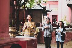 Trinity (solas53) Tags: vietnam temple hochiminh saigon prayer pray red holy people person woman