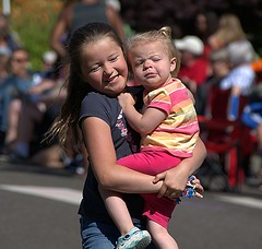 Carry Me (Scott 97006) Tags: girl kid child carry parade street cute
