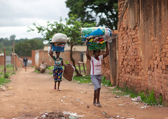 Women walking carrying sacks on head, Huambo Province, Huambo, Angola (Eric Lafforgue) Tags: activity adultsonly africa africanethnicity angola carrying clothing colourimage dailylife day ethnicity exterior fulllength heavy horizontal huambo humanbeing indigenousculture lifestyles novalisboa onthemove outdoors people photograph photography portrait ruralscene sack sidewalk standing street traditionalclothing twopeople walking womenonly working angango4595 huamboprovince