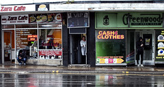 and they say it's grim up north (Mick Steff) Tags: burnley northern north vip shops road people sitting standing sex street urban shop