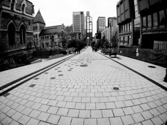 Rue University Downtown Montreal (MassiveKontent) Tags: gopro streetphotography montreal bw contrast city monochrome urban blackandwhite streetphoto metropolis montréal quebec photography bwphotography streetshot architecture asphalt concrete shadows noiretblanc blancoynegro skyscraper glass lines sky building road