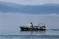 Camo Boat (peterkelly) Tags: digital canon 6d gadventures transmongolianadventure asia russianfederation russia siberia lakebaikal listvyanka motorboat hat camoflauge water