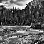 The Kicking Horse River Flowing By the Mountains at Natural Bridge (Black & White, Yoho National Park) thumbnail