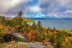 Rainbow at Sugarloaf Mountain in Autumn, Marquette Michigan (Craig - S) Tags: michigan upperpeninsula autumn background fall leaves nature outdoors tourism travel marquette granite rock blazing color vivid orange yellow green red foliage sugarloaf mountain hills pine fir maple tree hardwood woods wilderness forest overlook scenic vista viewing rainbow sky clouds dramatic littlepresqueisle lakesuperior greatlakes