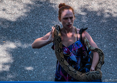 2018 - Vancouver - Pride Parade - 5 of 9 - Snakes Alive ! (Ted's photos - Returns Late November) Tags: 2018 bc britishcolumbia canada cropped nikon nikond750 nikonfx tedmcgrath tedsphotos vancouver vancouverbc vancouvercity vignetting snake shadow one onesnake 2018vancouverprideparade vancouverprideparade shadows female girl