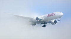 Swiss Boeing 777-300 appearing out of the fog in Zurich (PH-OTO) Tags: zrh zurich airport kloten fall autumn boeing 777 300 er swiss airline airliner aircraft aviation fog mist condensation