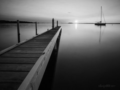 That jetty again (astrogirl969) Tags: fujifilm xe1 samyang12mmf20ncssc monochrome blackandwhite postprocessed silverefexpro dark moody boat water lake jetty morning dawn sunrise sun tranquil nd64 haidandfilters longexposure lowlight outdoor sky distortioncorrection silhouette 30faves 1000views