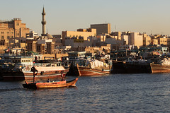 Deira, Dubai (mopics347) Tags: dubai deira boat dhow abra water creek minaret city uae united arab emirates outdoor cityscape ship merchandise shipping