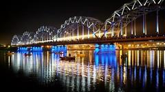 Water & Light Magic. (MarxschisM) Tags: river bridge night long exposure riga latvia light fishermen fujifilmxt1 meike28mm