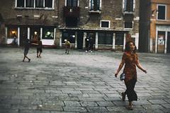 Leaving the Scene (Marta Marcato) Tags: woman dress flower venezia venice kids children play playing ball soccer calcio street streetphotography movement outdoor doors italy italia nikond7200