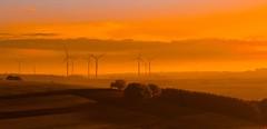 no wind (geraldkoenigsohn) Tags: backlight mist fog windgenerator fujixt1 colour sun sky horizon germany eifel landscape orange sunset