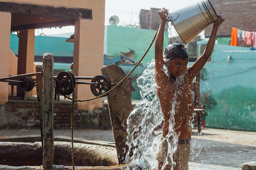 Boy Bucket Bathing, Mathura India