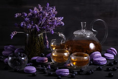 Lavander tea with macarons (Speleolog) Tags: tea food macarons background dark macaroon france cup sweet vintage french warm style wooden traditional delicious gourmet dessert cream cookie biscuit lighting macaron closeup tasty cuisine pastry black berry blueberry blackberry sour lavender violet purple teapot glass mood still life almond rustic fancy blue berries