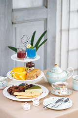 Afternoon tea. Tea party with unicorn macarons, scones, bakeries (enchanted.fairy) Tags: afternoon background baked british buffet cake cakestand champagne classic clotted cream cup cupcake dessert drink elegant english flute food garden gourmet high jam luxury muffin nobody old outdoor party pastry plate posh restaurant sandwich sandwiches scone scones set snack stand strawberry sugar summer sweet table tea teapot traditional tray white