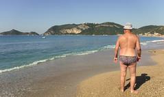 2018 09 30 Pat on beach at St George's north (pj's memories) Tags: corfu stgeorgesbaynorth beach seaside speedos trunks tanthru kiniki
