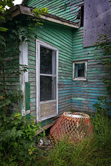 anybody home? (freakingrabbit) Tags: house residential structure porch patio hut wood derelict old green door ruin petty harbour newfoundland overgrown