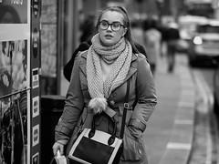 Haymarket London (Stuart Mac) Tags: candid street london mono fuji xt2 56mm f12 woman winter scarf glasses looking