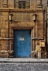 Originality (Ghada Elchazly) Tags: egypt cairo oldcairo old oldish colors doors history photo photography nikon photostream ilovephotography islamic islamicarchitecture islamicart texture blue balance arabicwords