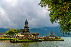 Ulun Danu Beratan Temple (Wolfhowl) Tags: 2018 historic reflection building asia bali old landmark august waterfront grass lake indonesia picturesque clouds ancient trees summer colorful attraction religious travel rocks sky island architecture hinduism statues landscape temple god