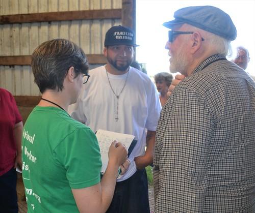 Joy Warren & Sam Trickey talking to Ramon Torres, founding member of Tierra & Libertad Co-op