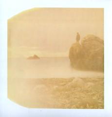 the essential (www.matteovarsi.com) Tags: polaroid expiredfilm vivafilm colorfilm pinhole pinholecamera seashore nature portrait cliff rocks beach sand man