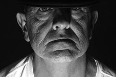 Man up (Wilamoyo) Tags: face monochrome black white close wrinkles hat cap man male masculine ligting lit studio selfie